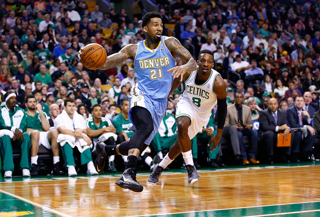. BOSTON, MA - DECEMBER 06: Wilson Chandler #21 of the Denver Nuggets drives to the basket in the second half past Jeff Green #8 of the Boston Celtics during the game at TD Garden on December 6, 2013 in Boston, Massachusetts.  (Photo by Jared Wickerham/Getty Images)