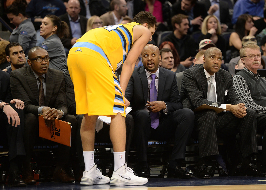. DENVER, CO. - FEBRUARY 27, 2014: Evan Fournier listened to Brian Shaw after the coach took him out of the game. The Denver Nuggets hosted the Brooklyn Nets at the Pepsi Center Thursday night, February 27, 2014. Photo By Karl Gehring/The Denver Post