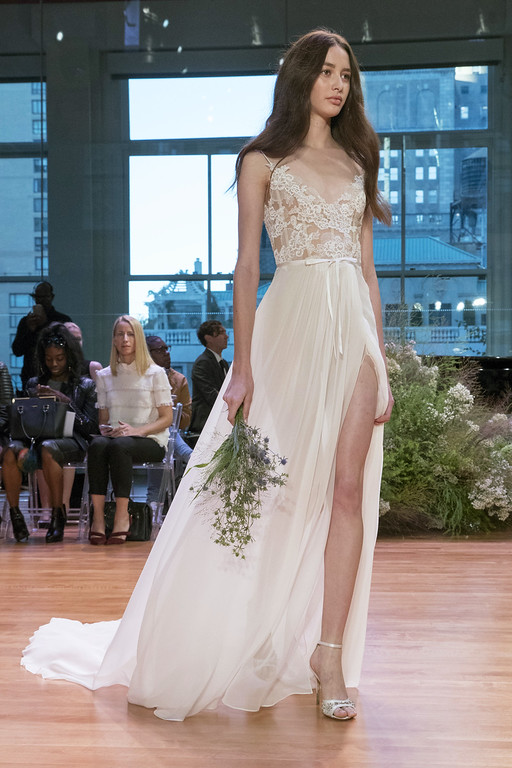 . In this Friday, Oct. 7, 2016 photo, the Monique Lhuillier bridal collection is modeled during bridal fashion week in New York.  (AP Photo/Mary Altaffer)