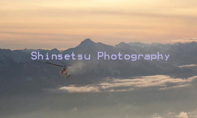 Heli descends to Revelstoke.jpg