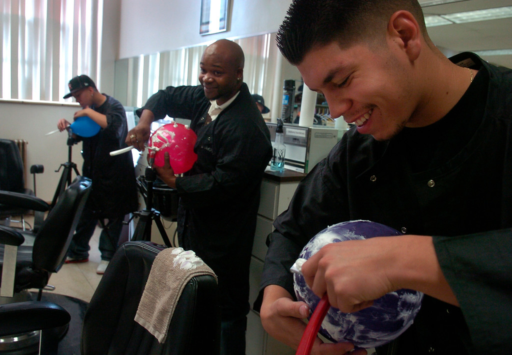. Barber students at the Emily Griffith Opportunity School learn the correct shaving techniques of shaving by using a blown up balloon, shaving cream, and a razor in 2008. These are level one students who must complete four levels to complete their credit hours and then take the state exam to get licensed. It takes each students about nine months to complete all the levels. Level one students from right to left, Brandon Torres, 23, James Griffin, 29, and Danielle Lanford, 21. Kathryn Scott Osler, The Denver Post