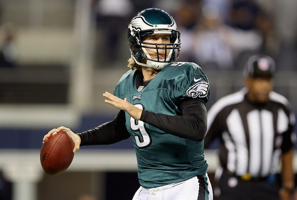 . Nick Foles #9 of the Philadelphia Eagles throws the ball against the Dallas Cowboys at Cowboys Stadium on December 2, 2012 in Arlington, Texas.  (Photo by Ronald Martinez/Getty Images)