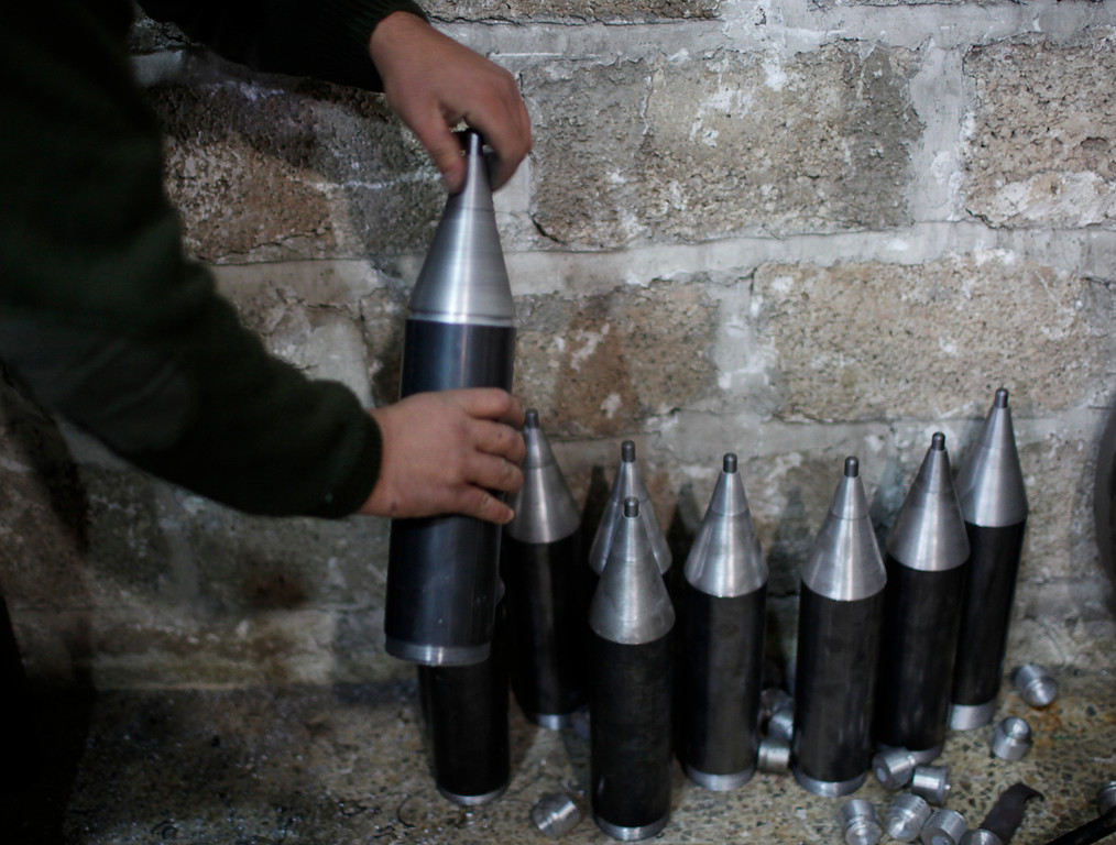 . A Free Syrian Army fighter makes homemade missiles at a workshop in north Aleppo December 29, 2012.  REUTERS/Ahmed Jadallah