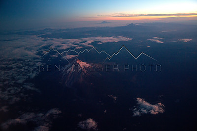 Mount Hood, OR., Mount St. Helens and Mount Adams, WA. at sunrise, from a jet