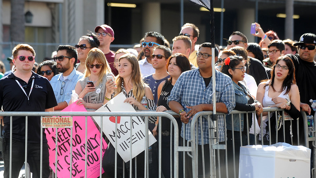 . Fans wait to see Paul McCartney perform on Hollywood Boulevard in Hollywood, CA Monday, September 23, 2013.  A portion of Hollywood Boulevard will be closed from Highland to Orange through Wednesday morning to make way for two concerts planned for �Jimmy Kimmel Live.� (Andy Holzman/Los Angeles Daily News)