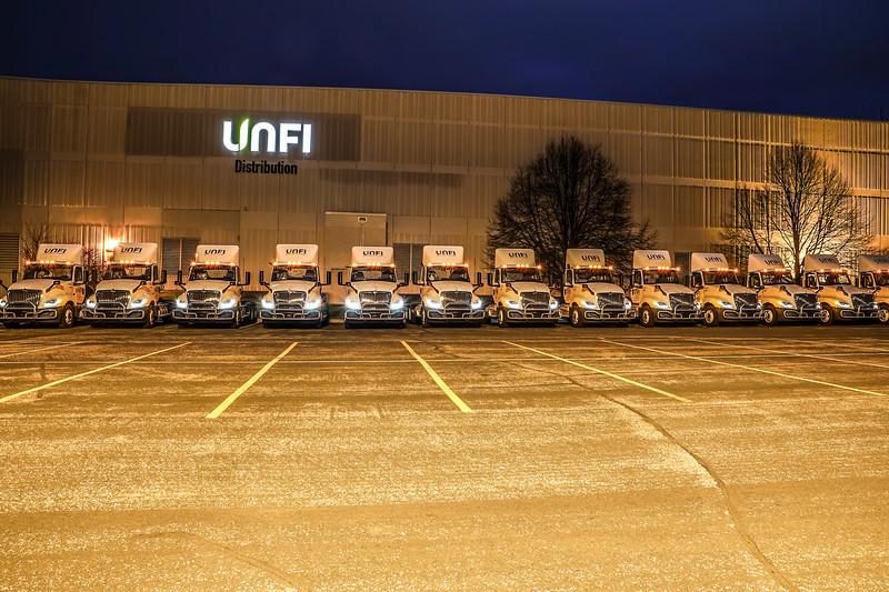 Unfi trucks line up.JPG