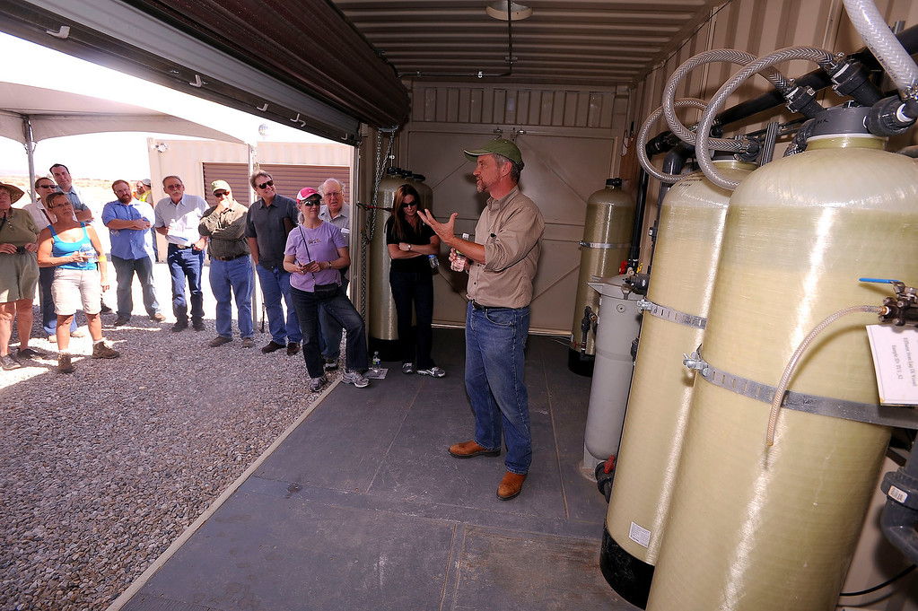 . Kevin Sullivan of Pacific Gas and Electric Company speaks to a tour group about a Whole House Water system at an agriculture unit in Hinkley June 13, 2012.   GABRIEL LUIS ACOSTA/STAFF PHOTOGRAPHER.