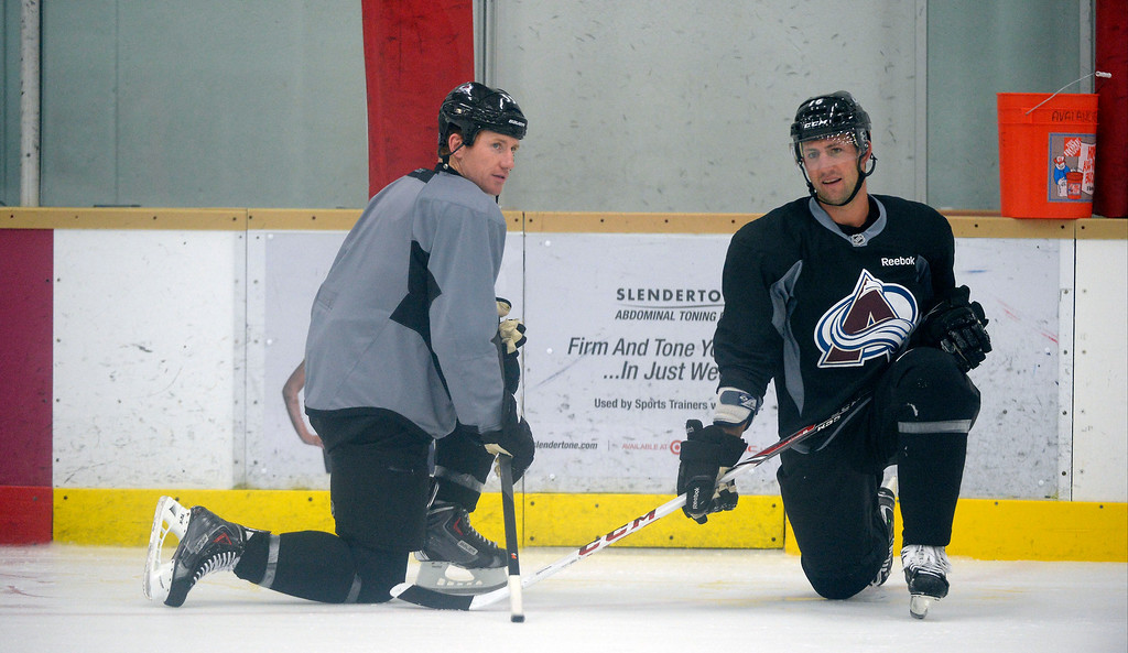 . Colorado Avalanche LW Cody McLeod (55) talks with Colorado Avalanche D Cory Sarich (16) (R) during practice September 9, 2013 at Family Sports Ice Arena. (Photo By John Leyba/The Denver Post)