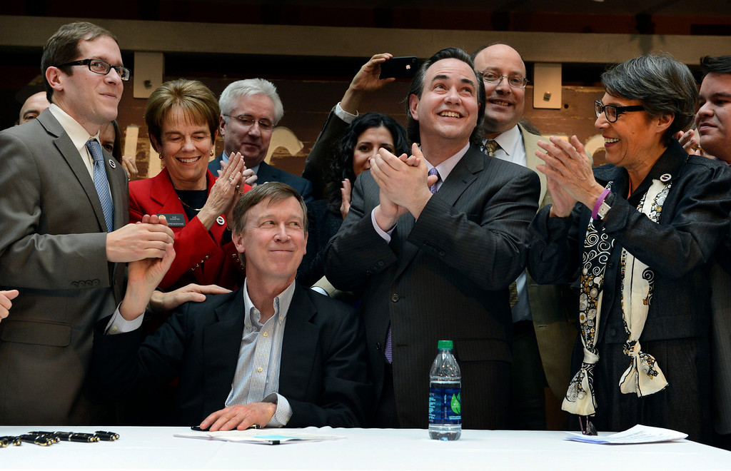 . DENVER, CO. - MARCH 21: Governor John Hickenlooper, seated, celebrates with (l-r) Speaker Mark Ferrandino, Representative Sue Schafer, and Sens. Pat Steadman and Lucia Guzman after signing the Colorado Civil Union Act at the History Colorado Center in  Denver, CO March 21, 2013. The bill was sponsored by Ferrandino, Schafer, Steadman and Guzman, four openly gay lawmakers. Colorado is one of 18 states that offer recognition of same-sex couples, either through marriage or civil unions, according to the state\'s largest gay-rights group, One Colorado.  (Photo By Craig F. Walker/The Denver Post)