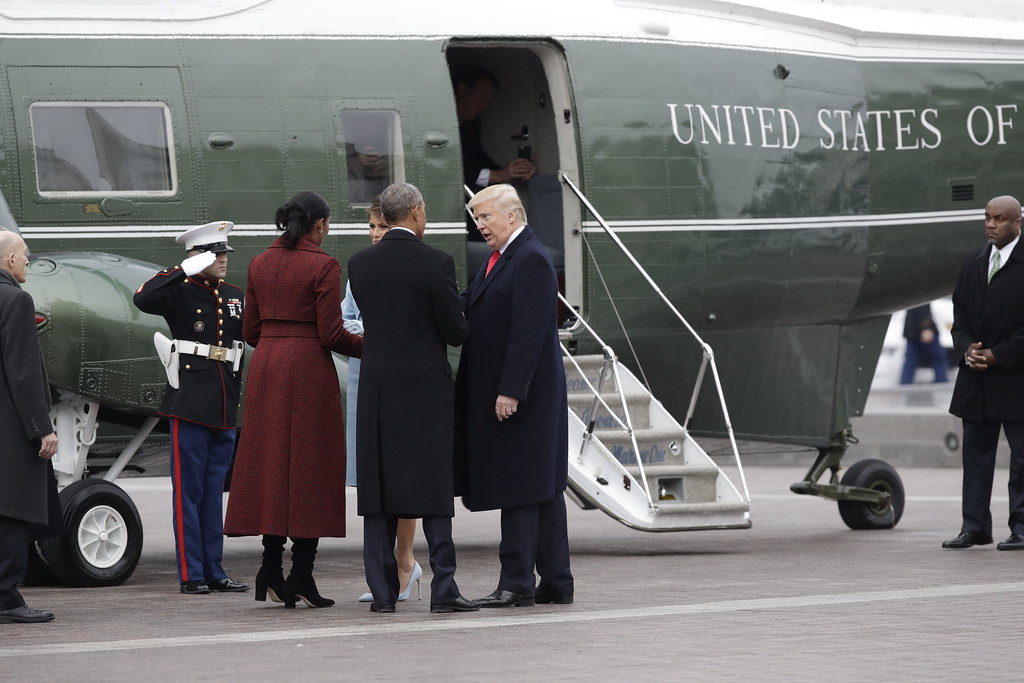 . President Donald Trump and first lady Melania Trump talk with former President Barack Obama and Michelle Obama during a departure ceremony on the East Front of the U.S. Capitol in Washington, Friday, Jan. 20, 2017, after Trump was inaugurated. (AP Photo/Evan Vucci)