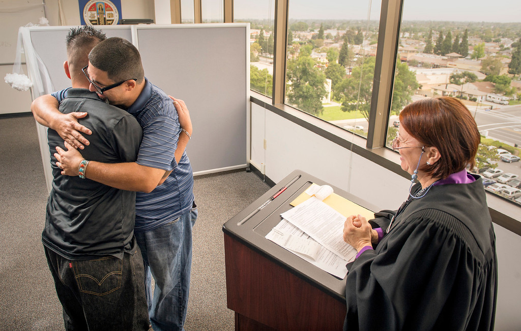 . Joseph Vega, 44, and David Martinez, 35, embrace after exchanging vows during a civil ceremony performed by deputy commissioner Elizabeth Oakes at the Los Angeles County Registrar-Recorder/County Clerk office in Norwalk, Ca. July 1, 2013.   (SGVN staff photo by Leo Jarzomb)