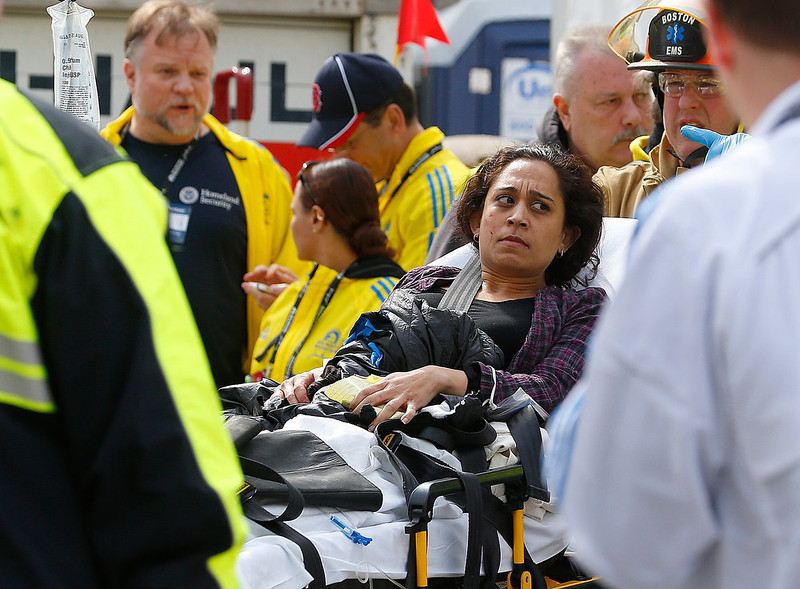 . A woman is loaded into an ambulance after he was injured by one of two bombs exploded during the 117th Boston Marathon near Copley Square on April 15, 2013 in Boston, Massachusetts. Two people are confirmed dead and at least 23 injured after two explosions went off near the finish line to the marathon.  (Photo by Jim Rogash/Getty Images)