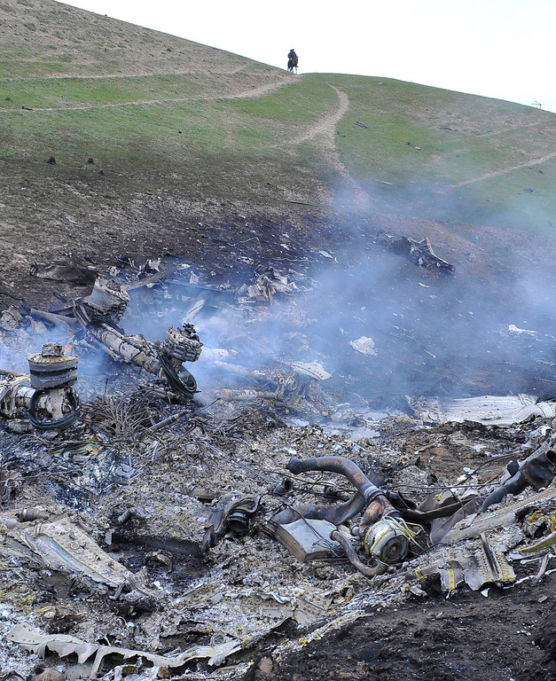 . The wreckage of the Boeing KC-135 Stratotanker plane is seen at the site of the crash near the Kyrgyz village of Chaldovar, May 3, 2013.REUTERS/Sabyr Alichiev/Pool