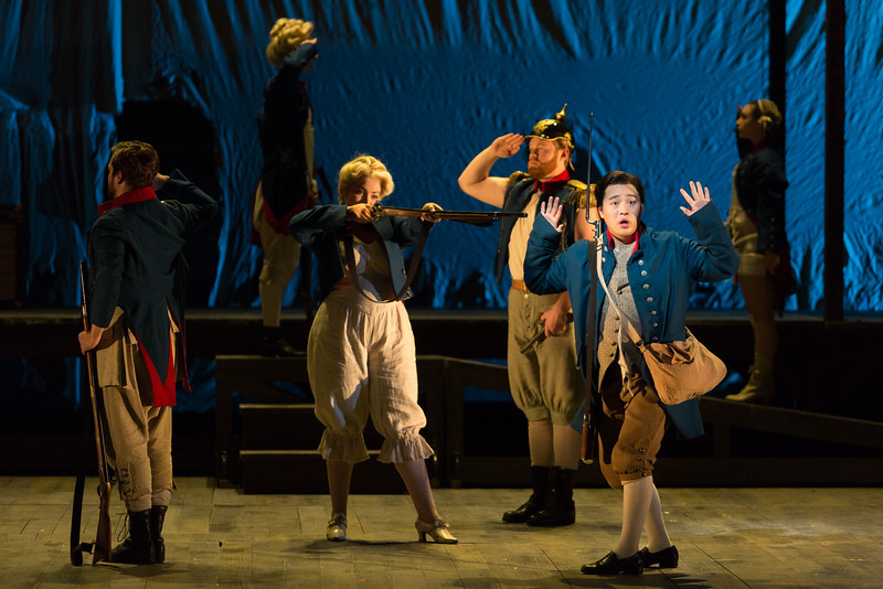 """Andrew Stenson as Candide and ensemble in The Glimmerglass Festival's 2015 production of Bernstein's """"Candide."""" Photo: Karli Cadel/The Glimmerglass Festival."""