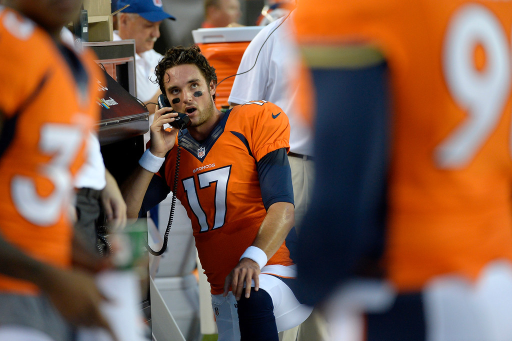 . Brock Osweiler (17) of the Denver Broncos talks on the phone between possessions against the Arizona Cardinals during the last pre-season game of the season at Sports Authority Field at Mile High. August 29, 2013 Denver, Colorado. (Photo By Joe Amon/The Denver Post)
