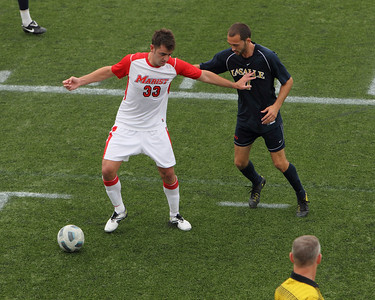 POUGHKEEPSIE, NY - SEPTEMBER 26: Marist Mens Soccer verses La Salle at Marist College on September 26, 2010 in Poughkeepsie New York.  Marist's  #33 James Curley beats La Salle player to ball. Photo by Sandy Tambone