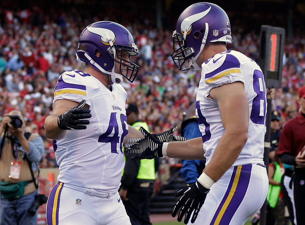 . Vikings running back Zach Line, left, celebrates after scoring on a one-yard touchdown reception with tight end John Carlson during the second quarter against the 49ers.  (AP Photo/Marcio Jose Sanchez)