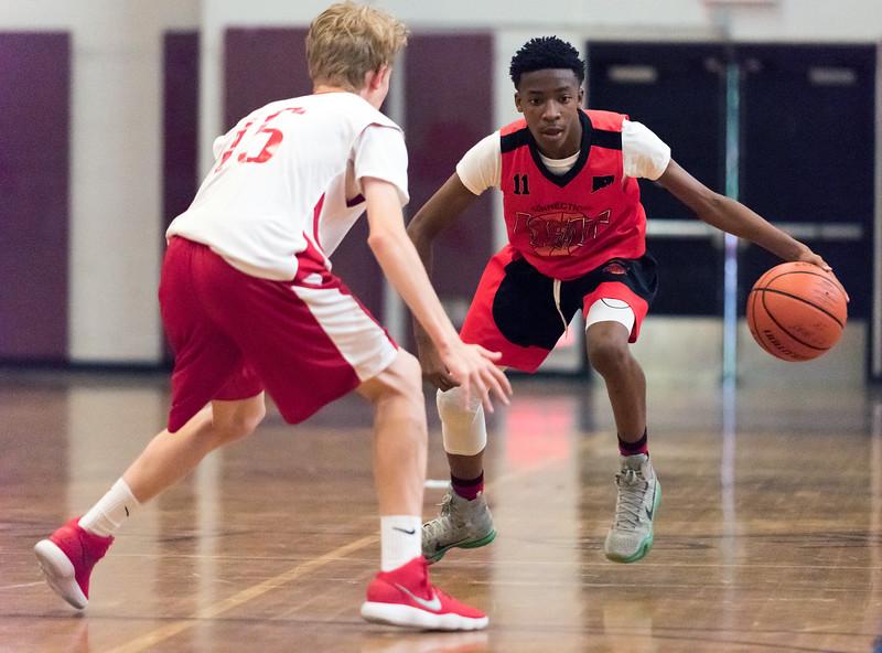 08/01/18  Wesley Bunnell | Staff  CT Heat (New Britain) vs Vale in Nutmeg Games boys 14U basketball at New Britain High School on Wednesday evening. Nasir Walker Jenkins (11).