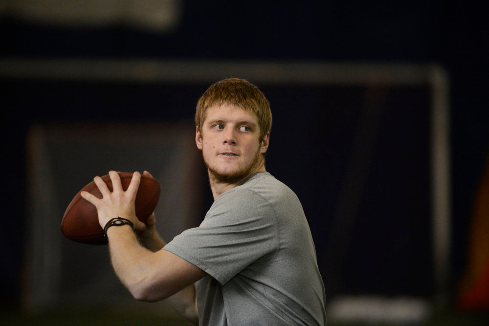 . Former Kansas State star quarterback, Collin Klein, during a passing drill with former Denver Broncos quarterback, Jake Plummer inside the South Suburban Parks and Recreation\'s Sport Dome in Centennial, Colorado, Thursday morning, February 14th, 2013.  Plummer has spent weeks with Klein preparing him for the upcoming NFL Scouting Combine in Indianapolis, Indiana February 20th thru February 26th 2013. (Photo By Andy Cross / The Denver Post)