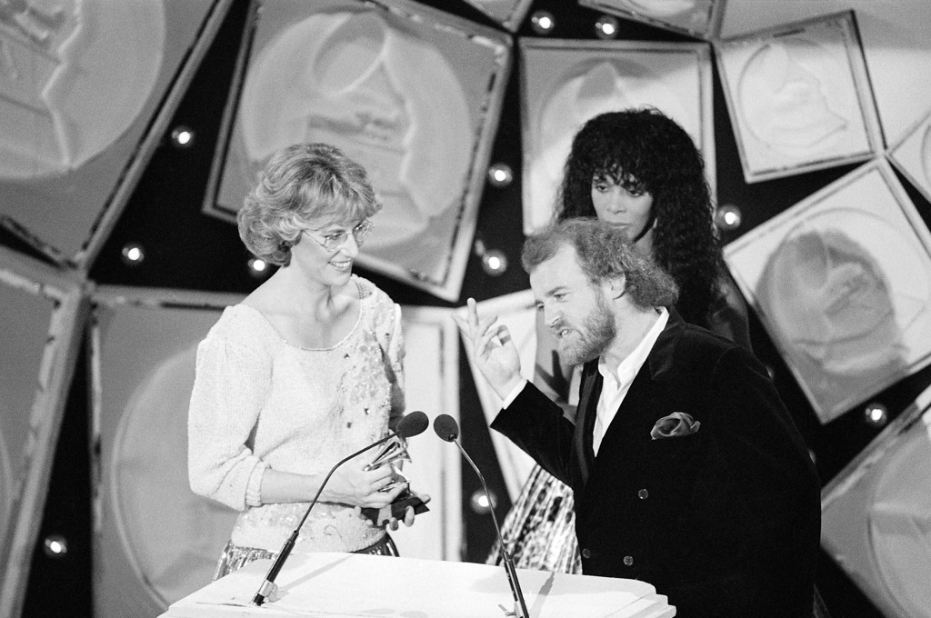 ". British singer Joe Cocker, left, acknowledges the crowd as he and country singer Jennifer Warnes accept their Grammy award Wednesday night February 24, 1983 after being named winners in the ""Best Pop Vocal by a Duo\"" category during the 25th annual Grammy Awards presentations in Los Angeles. (AP Photo)"