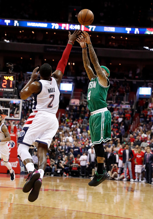 . Boston Celtics guard Isaiah Thomas (4) shoots over Washington Wizards guard John Wall (2) during the second half of Game 6 of an NBA basketball second-round playoff series, Friday, May 12, 2017, in Washington. The Wizards won 92-91. (AP Photo/Alex Brandon)