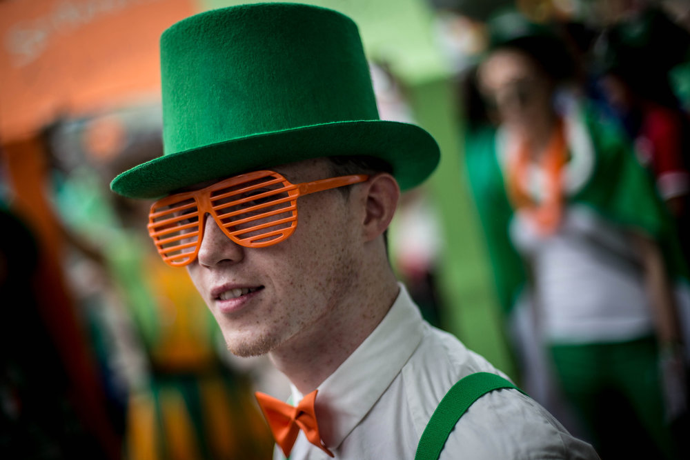 . A man dressed in costume waits for the parade to start during the Singapore St. Patrick\'s Day Street Festival at Boat Quay on March 17, 2013 in Singapore. Singapore\'s Irish community gathered at Boat Quay for a three-day-long St. Patrick\'s Day Street Festival which featured street performances, buskers, and Irish food and drink.  (Photo by Chris McGrath/Getty Images)