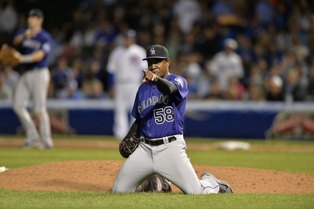 . Starting pitcher Yohan Flande #58 of the Colorado Rockies points to third baseman Nolan Arenado after Arenado made a play during the sixth inning against the Chicago Cubs on July 28, 2014 at Wrigley Field in Chicago, Illinois.  (Photo by Brian Kersey/Getty Images)