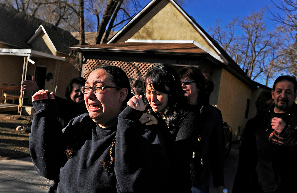 . Stephanie Cordova, left, mother of 9-year-old Calysta Cordova, reacts with family and friends, Friday, Jan. 20, 2012, outside her home in Pueblo, Colo., after getting the news that her daughter, who was abducted, has been found alive.