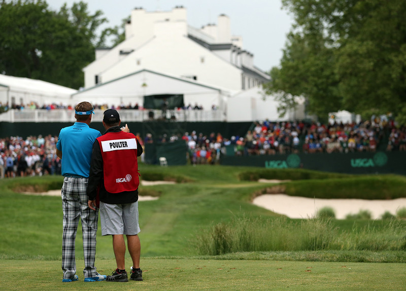 . Ian Poulter of England talks with caddie Terry Mundy on the 13th tee during Round One of the 113th U.S. Open at Merion Golf Club on June 13, 2013 in Ardmore, Pennsylvania.  (Photo by Andrew Redington/Getty Images)