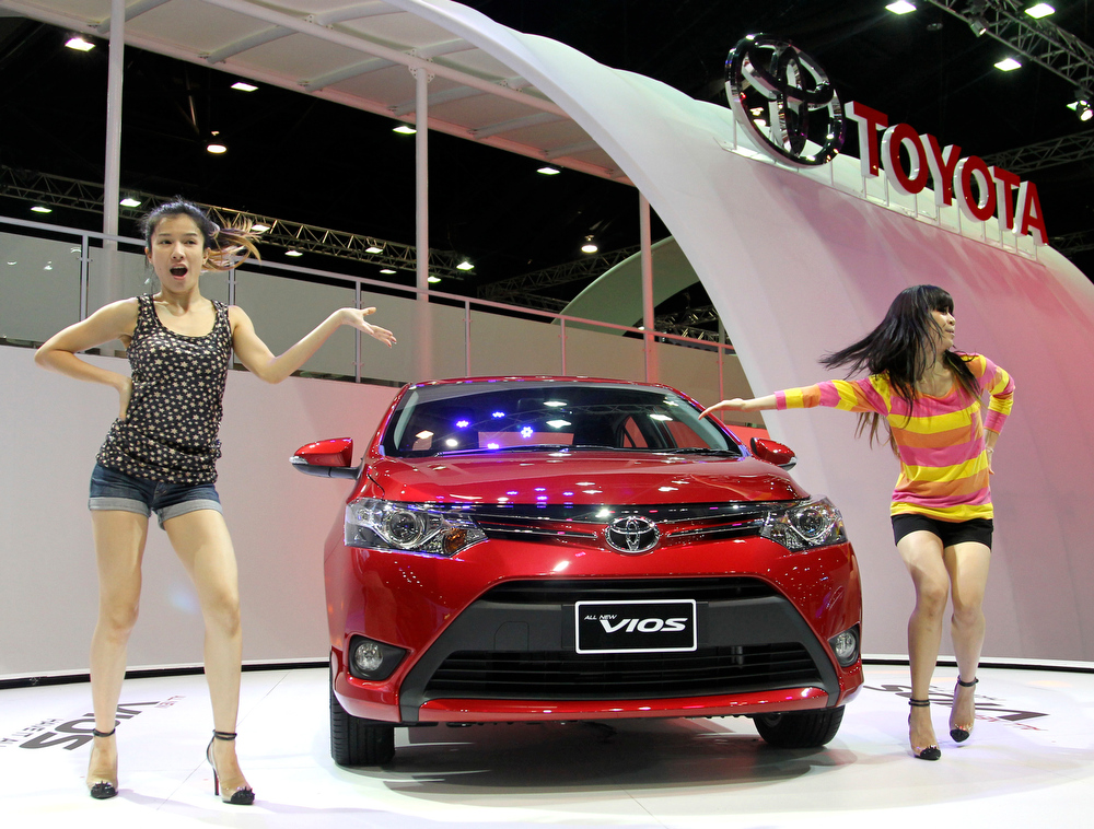 . Thai danvcers introduce a brand-new Toyota Vios on the press day of the Bangkok Motor Show in Bangkok, Thailand, Tuesday, March 26, 2013. The compact sedan made its world debut at the auto show on Monday. The 34th running of the show is opened to the public from Wednesday. (AP Photo/Sakchai Lalit)