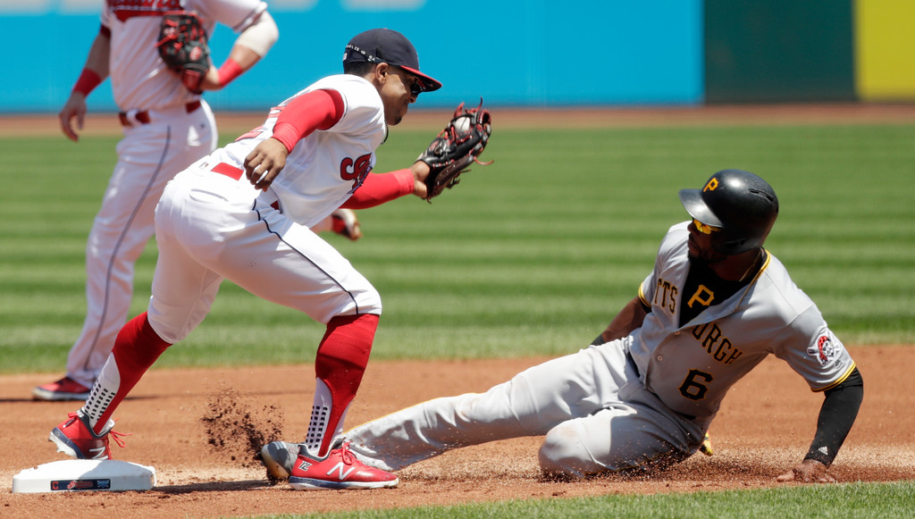 . Pittsburgh Pirates\' Starling Marte is tagged out by Cleveland Indians\' Francisco Lindor trying to steal to second base in the first inning of a baseball game, Wednesday, July 25, 2018, in Cleveland. (AP Photo/Tony Dejak)