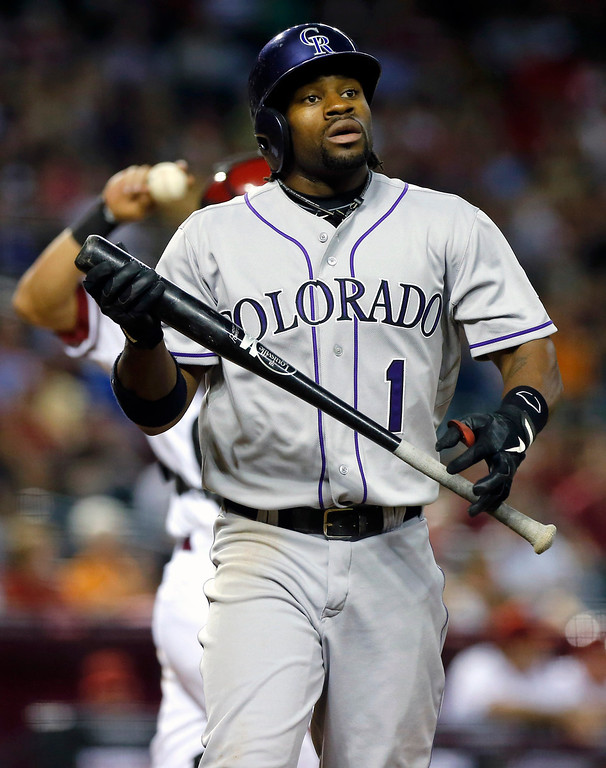 . Colorado Rockies\' Eric Young Jr. walks to the dugout after striking out against the Arizona Diamondbacks during the third inning of a baseball game, Thursday, April 25, 2013, in Phoenix. (AP Photo/Matt York)
