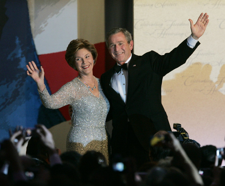 . In this Jan. 20, 2005, file photo, President Bush and first lady Laura Bush wave to the crowd after dancing at the Constitution Ball at the Washington Hilton Hotel during the 55th Presidential Inaugural celebration in Washington, D.C. The designer, who died Monday, Oct. 20, 2014, at 82, shaped American couture half a century ago when it emerged as a serious rival to European fashion designers. His specialty was evening gowns, and celebrities from Penelope Cruz and Sarah Jessica Parker to former first ladies Laura Bush and Hillary Rodham Clinton wore his creations. (AP Photo/Elise Amendola)