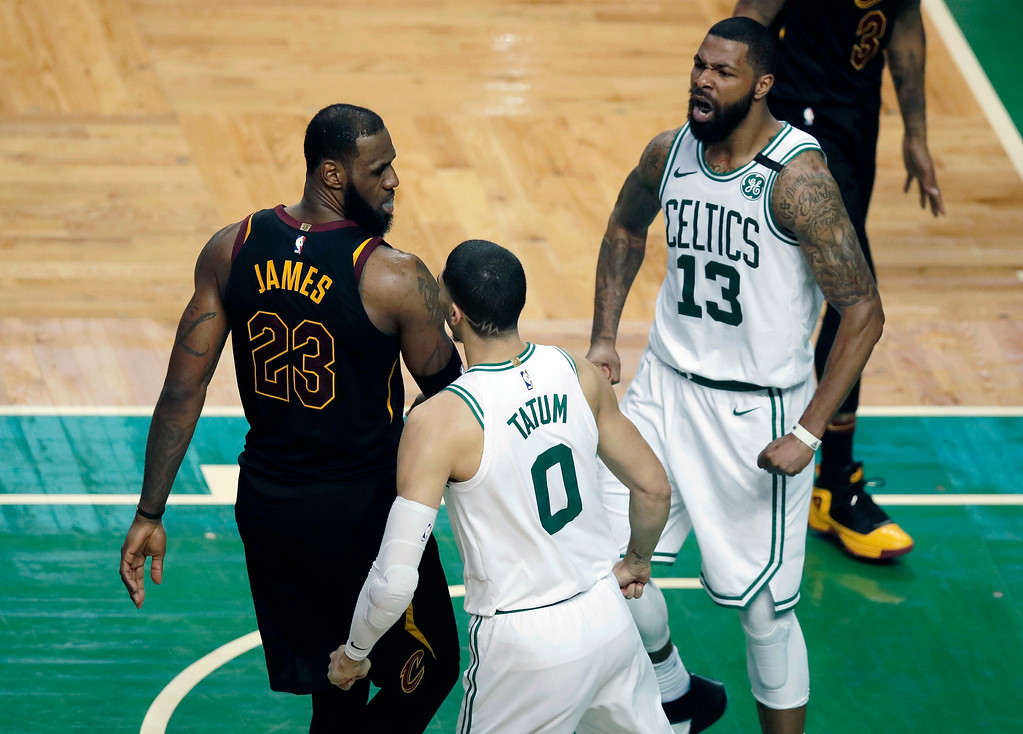 . Boston Celtics forward Jayson Tatum (0) and Boston Celtics forward Marcus Morris, right, celebrate Tatum\'s dunk against Cleveland Cavaliers forward LeBron James, left, during the second half in Game 7 of the NBA basketball Eastern Conference finals, Sunday, May 27, 2018, in Boston. (AP Photo/Charles Krupa)