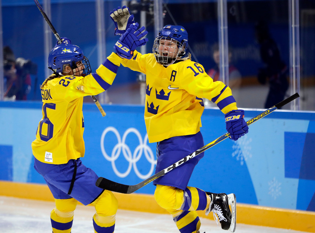 . Pernilla Winberg (16) celebrates with Hanna Olsson (26), of Sweden, after scoring a goal against the combined Koreas during the second period of the preliminary round of the women\'s hockey game at the 2018 Winter Olympics in Gangneung, South Korea, Monday, Feb. 12, 2018. (AP Photo/Julio Cortez)