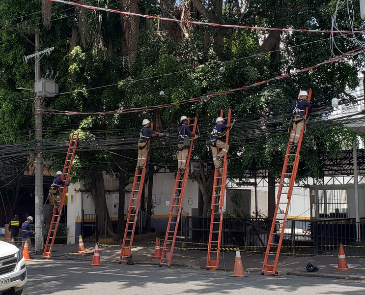 Coordinated team effort to repair old phone lines - in front of our hotel.