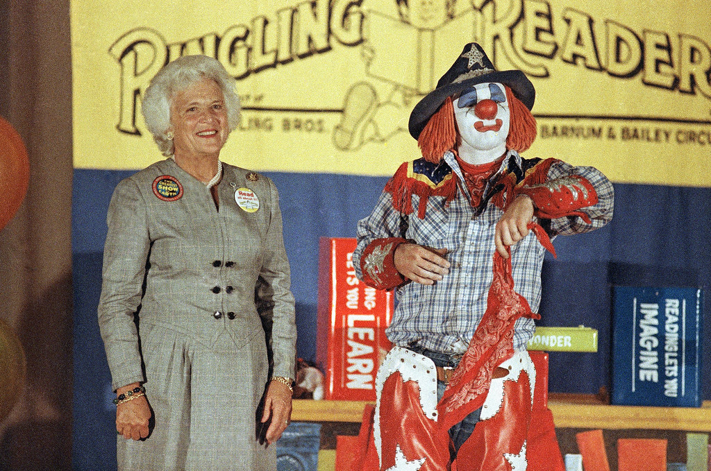 """. Mrs. George Bush, wife of Vice-President George Bush, reacts as Ringling Bros. and Barnum and Bailey Circus clown Mike """"Cowboy Mike"""" Keever, jokes with her during a presentation to more than 300 school children at Greenlee Elementary School, Sept. 26, 1986 in Denver. (AP Photo/Aaron Tomlinson)"""