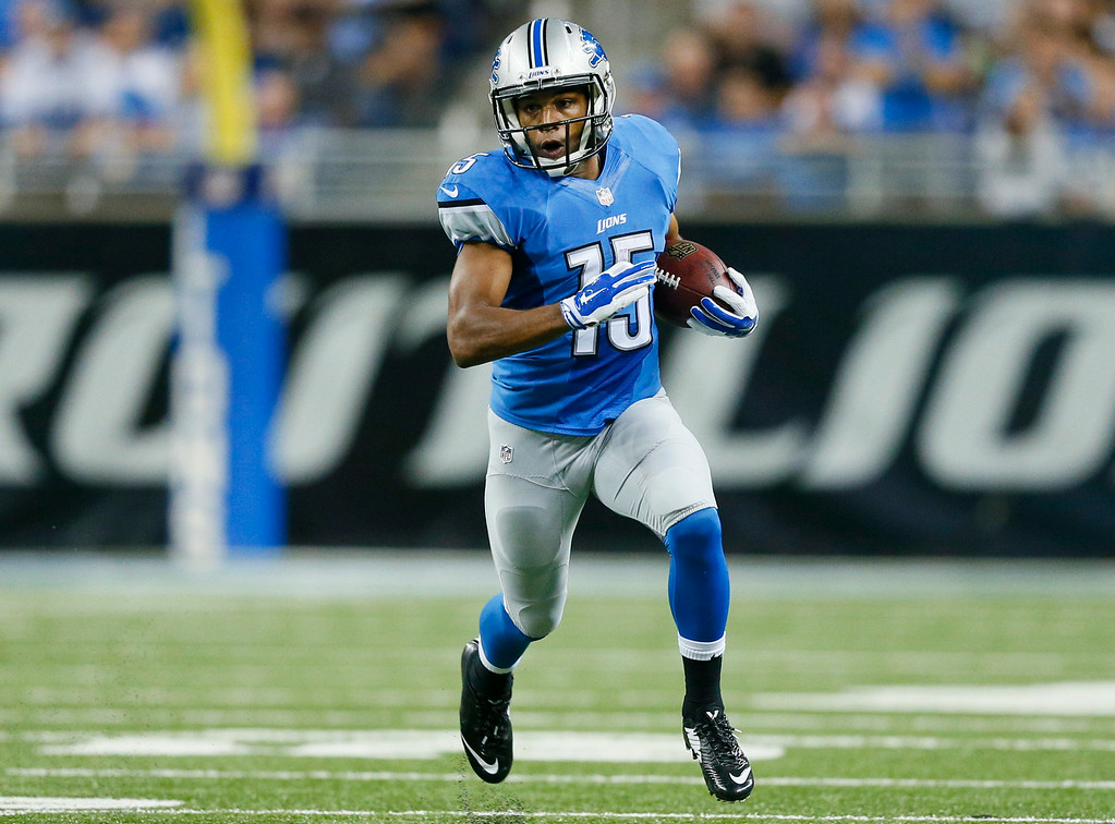 . Detroit Lions wide receiver Golden Tate (15) runs the ball after a catch against the Jacksonville Jaguars in the first half of a preseason NFL football game at Ford Field in Detroit, Friday, Aug. 22, 2014. (AP Photo/Rick Osentoski)