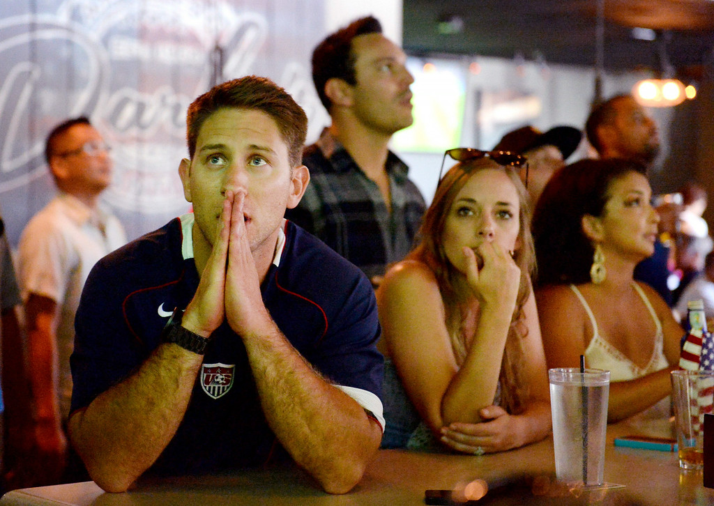 . Kyle Pattison, 31, of Lake Arrowhead, watches the final minutes of the USA vs Belgium world cup game during a viewing party on Tuesday, July 1, 2014 at Darby\'s American Cantina in Redlands, Ca. (Photo by Micah Escamilla/The Sun)