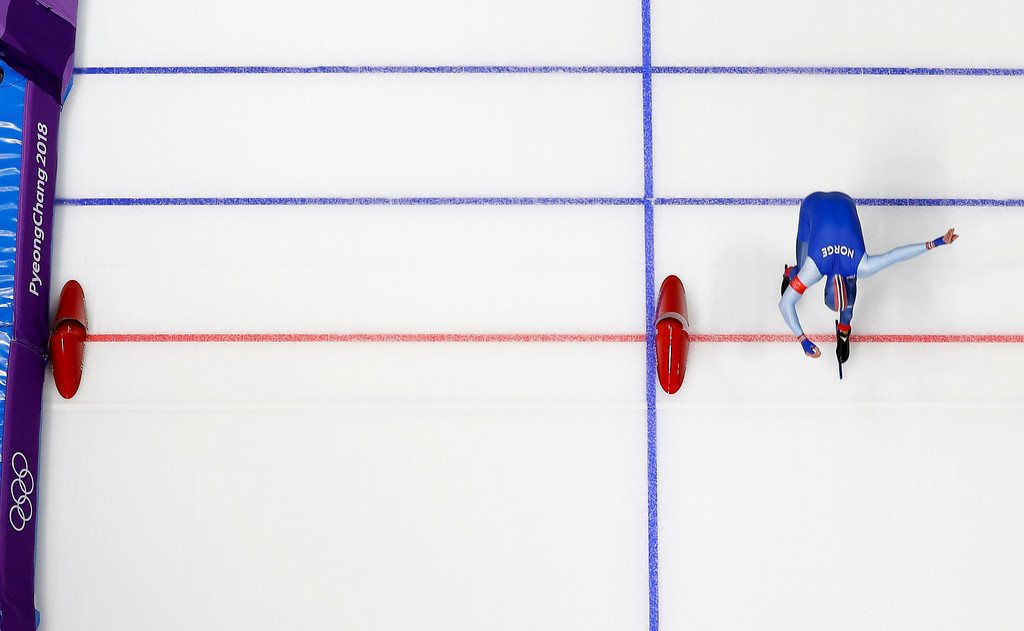 . Havard Lorentzen of Norway pushes his skate over the finish line to break the Olympic record set by Cha Min-kyu of South Korea two races earlier during the men\'s 500 meters speedskating race at the Gangneung Oval at the 2018 Winter Olympics in Gangneung, South Korea, Monday, Feb. 19, 2018. (AP Photo/Eugene Hoshiko)