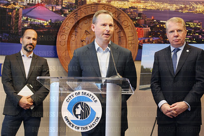 Travel technology giant Expedia announces in press conference at Seattle City Hall relocation of their company headquarters from Bellevue, Washington to Seattle, Washington