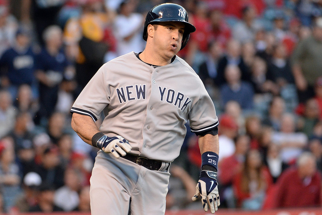 . New York Yankees\' Mark Teixeira rounds first base after hitting a RBI double in the first inning of a baseball game against the Los Angeles Angels at Anaheim Stadium in Anaheim, Calif., on Wednesday, May 7, 2014.  (Keith Birmingham Pasadena Star-News)