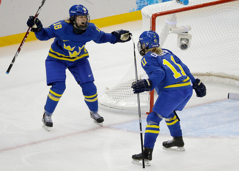 . Cecilia Ostberg of Sweden (11) celebrates her goal against Germany with teammate Anna Borgqvist (18) during the third period of the 2014 Winter Olympics women\'s ice hockey game at Shayba Arena, Tuesday, Feb. 11, 2014, in Sochi, Russia. (AP Photo/Mark Humphrey)