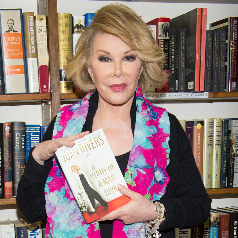 """. Television personality Joan Rivers makes an appearance at Book Revue to promote her new memoir \""""Diary of a Mad Diva\"""", in Huntington on Friday, July 25, 2014 in New York. (Photo by Scott Roth/Invision/AP)"""