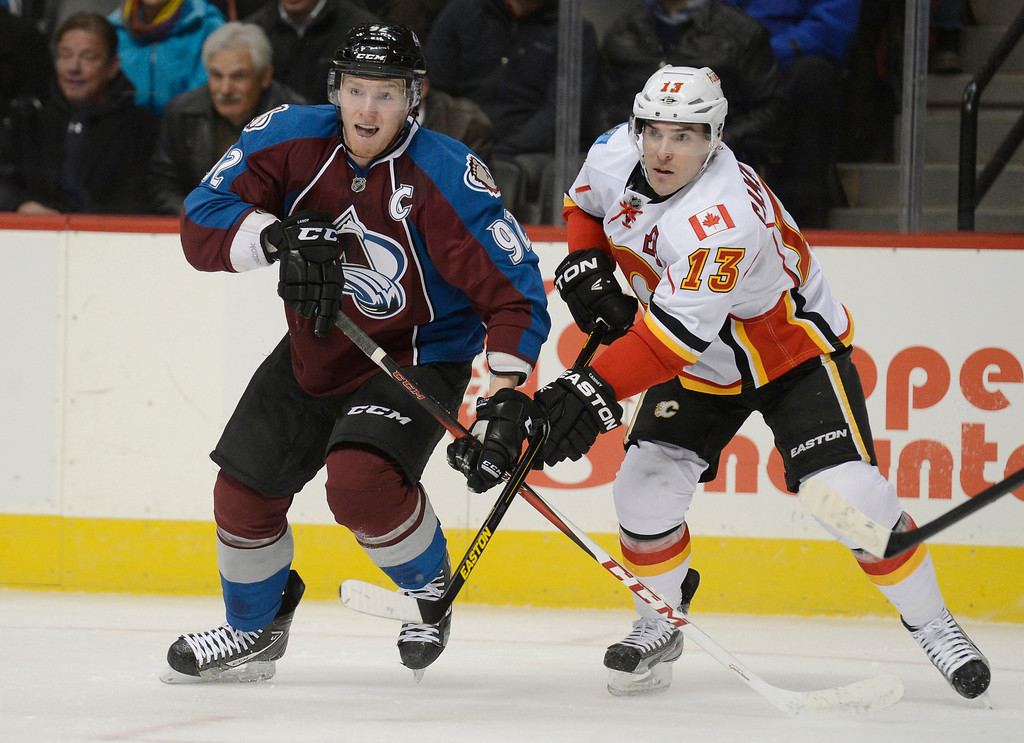 . DENVER, CO. - FEBRUARY 28: Gabriel Landeskog (92) of the Colorado Avalanche and Mike Cammalleri (13) of the Calgary Flames look for the puck during the first period February 28, 2013 at Pepsi Center.(Photo By John Leyba/The Denver Post)