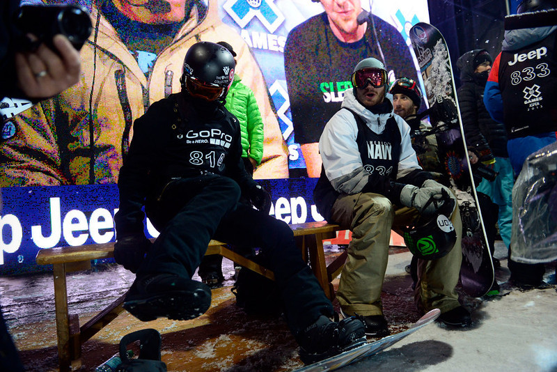 . ASPEN, CO. - JANUARY 24: Shaun White straps in as Scotty Lago sits nearby during the men\'s Snowboard Superpipe elimination. Men\'s Snowboard Slopestyle elimination X Games Aspen Buttermilk Mountain Aspen January 24, 2013 (Photo By AAron Ontiveroz / The Denver Post)