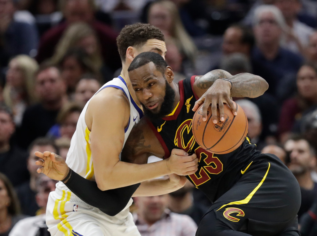 . Cleveland Cavaliers\' LeBron James goes to the basket against Golden State Warriors\' Klay Thompson in the first half of Game 4 of basketball\'s NBA Finals, Friday, June 8, 2018, in Cleveland. (AP Photo/Tony Dejak)