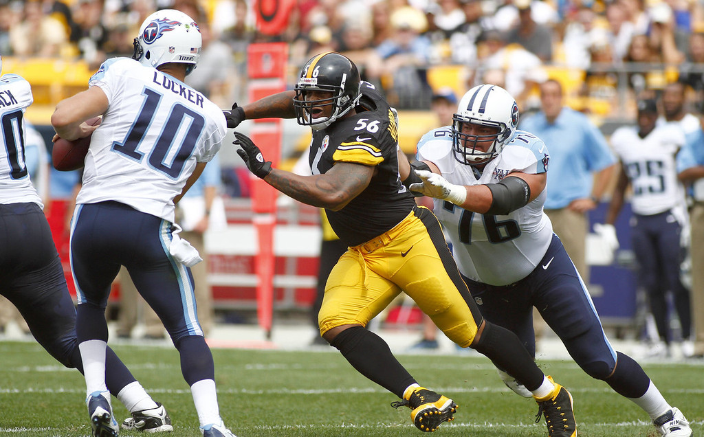 . LaMarr Woodley #56 of the Pittsburgh Steelers sacks Jake Locker #10 of the Tennessee Titans in the first half during the game on September 8, 2013 at Heinz Field in Pittsburgh, Pennsylvania.  (Photo by Justin K. Aller/Getty Images)
