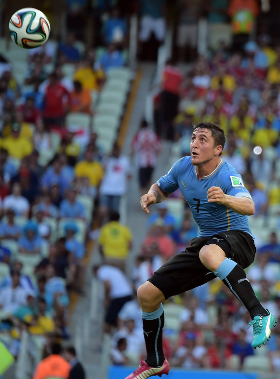 . Uruguay\'s midfielder Cristian Rodriguez plays the ball during a Group D football match between Uruguay and Costa Rica at the Castelao Stadium in Fortaleza during the 2014 FIFA World Cup on June 14, 2014. AFP PHOTO / GABRIEL BOUYS