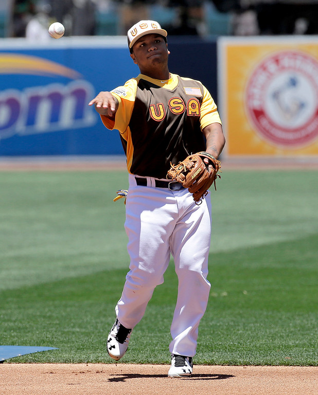 . U.S Team\'s Willie Calhoun, of the Los Angeles Dodgers, warms up prior to the All-Star Futures baseball game against the World team, Sunday, July 10, 2016, in San Diego. (AP Photo/Matt York)